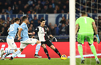 Football, Serie A: S.S. Lazio - Juventus Olympic stadium, Rome, December 7, 2019. <br /> Juventus' Cristiano Ronaldo (c) in action with Lazio's Stefan Radu (l) Luis Felipe (second from left) and goalkeeper Thomas Strakosha (r) during the Italian Serie A football match between S.S. Lazio and Juventus at Rome's Olympic stadium, Rome on December 7, 2019.<br /> UPDATE IMAGES PRESS/Isabella Bonotto