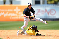 New York Yankees shortstop Jayson Nix #17 attempts to turn a double play as Brett Carroll slides in during a Spring Training game against the Pittsburgh Pirates at Legends Field on March 28, 2013 in Tampa, Florida.  (Mike Janes/Four Seam Images)