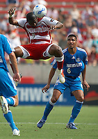 FC Dallas' Roberto Mina (9) connects on a header while KC Wizards' Jose Burciaga Jr. (6) looks on at Pizza Hut Park on Sunday April 23, 2006. Dallas beat Kansas City 2-1.