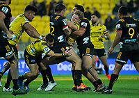 Jordie Barrett is wrapped up during the Super Rugby match between the Hurricanes and Chiefs at Westpac Stadium in Wellington, New Zealand on Friday, 27 April 2019. Photo: Dave Lintott / lintottphoto.co.nz