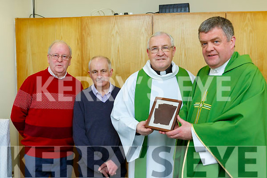 Fr Kieran O'Brien and Fr John Kerin with the Padre Pio relic  at the Church of the Ressurection Killarney on Monday evening with l-r: Michael Clifford and Jimmy Kennedy