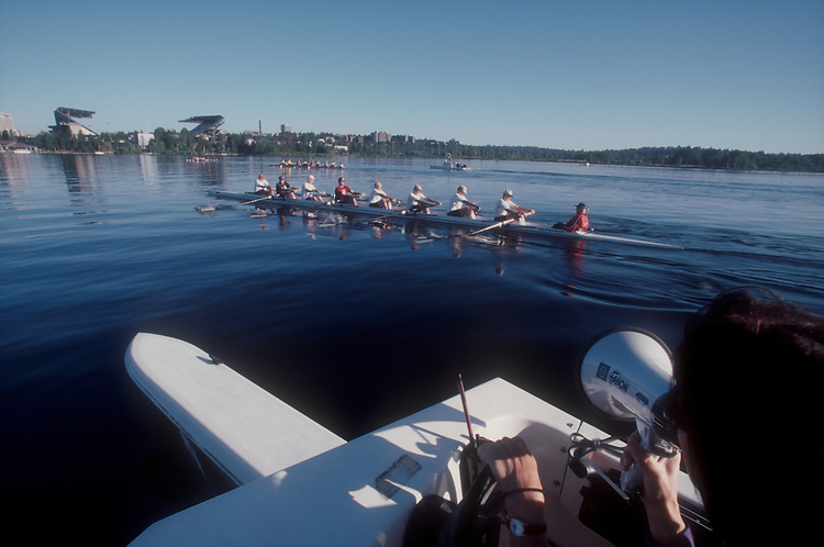 Seattle, Rowing coach, masters rowers, eight-oared racing shell, University of Washington in distance, Ancient Mariners; Rowing Club; Susan Parkman;