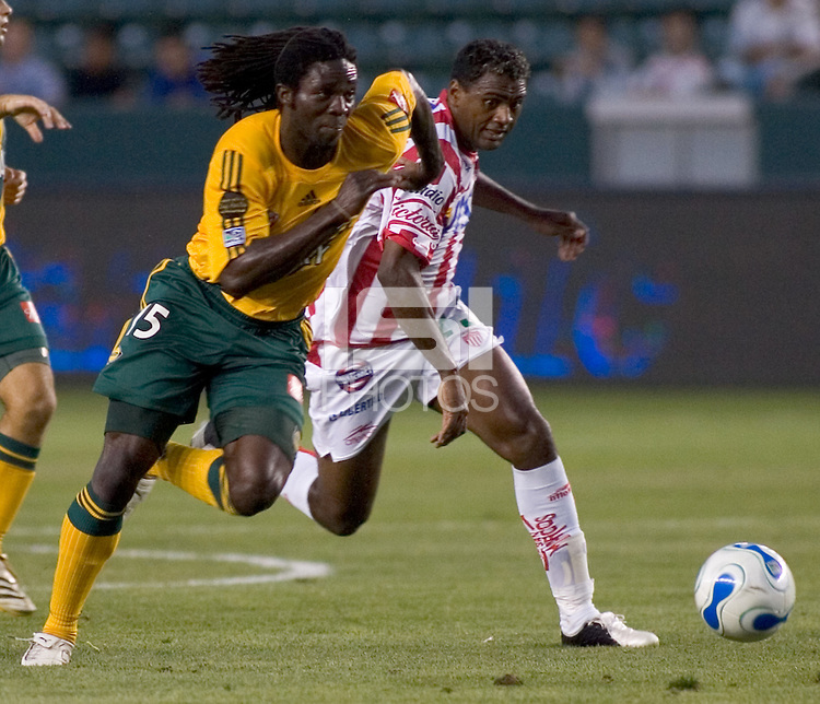 LA Galaxy Def Ugo Ihemelu battles for the ball against Brazilian Fwd Kleber Boas of Necaxa.  Necaxa defeated LA Galaxy in an International friendly match 1-0 at The Home Depot Center in Carson, California, Wednesday July 12, 2006.
