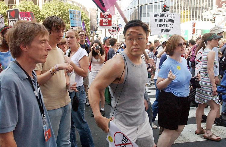 "8/29/04.2004 REPUBLICAN NATIONAL CONVENTION/PROTEST--After exchanging words with a Bush supporter, a Bush opponent reacts to being called a ""scumbag"" by the Bush supporter; during a protest against President Bush, the war in Iraq, and other issues. In the background is Madison Square Garden, site of the Republican convention..CONGRESSIONAL QUARTERLY PHOTO BY SCOTT J. FERRELL"