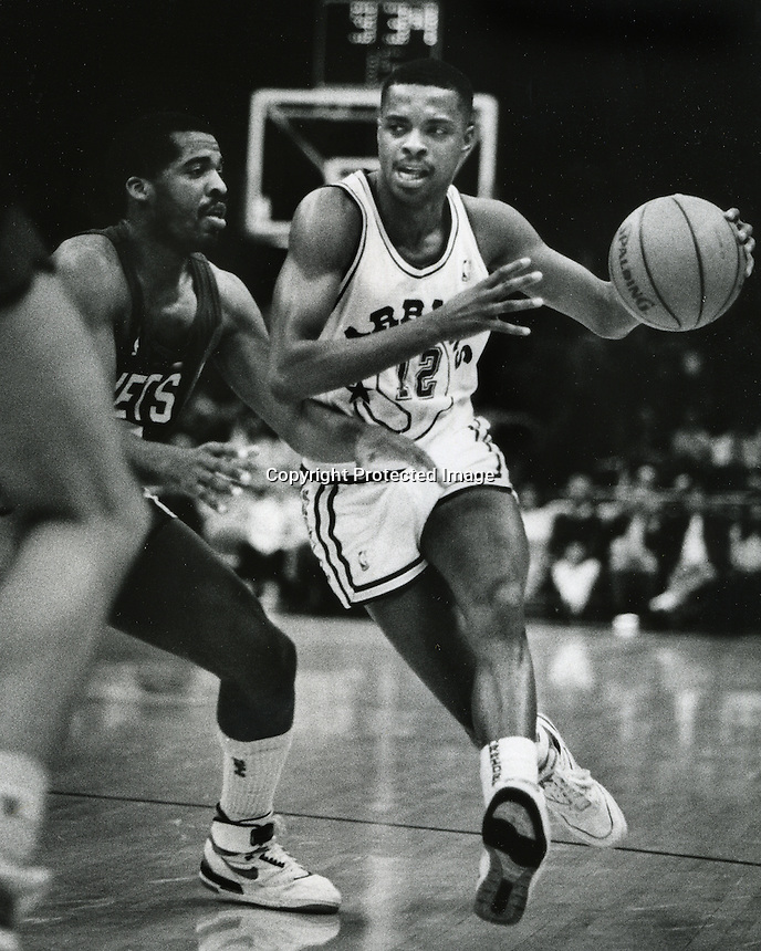 Golden State Waarriors #12 Wayne Garlan against the Denver Nuggets. (Ron Riesterer/photoshelter)