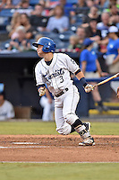 Asheville Tourists designated hitter Max George (3) swings at a pitch during a game against the Columbia Fireflies at McCormick Field on August 17, 2016 in Asheville, North Carolina. The Tourists defeated the Fireflies 7-6. (Tony Farlow/Four Seam Images)