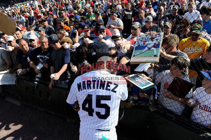 Former Boston Red Sox pitcher Pedro Martinez #45 signs autographs before the MLB Pepsi Max Field of Dreams game on May 18, 2013 at Frontier Field in Rochester, New York.  (Mike Janes/Four Seam Images)