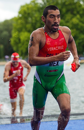07 AUG 2011 - LONDON, GBR - Crisanto Grajales (MEX) runs from the swim during the men's round of triathlon's ITU World Championship Series (PHOTO (C) NIGEL FARROW)