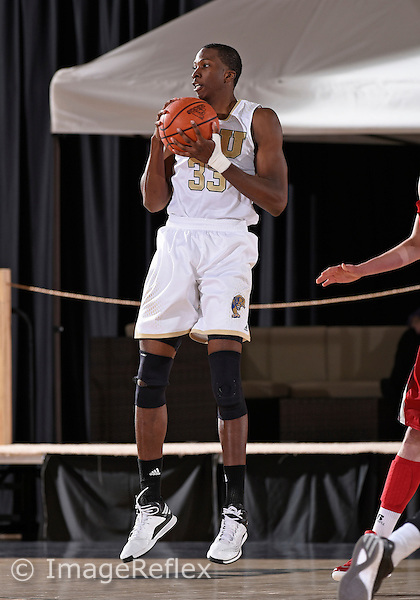 Florida International University center Michael Phillip (33) plays against Western Kentucky University which won the game 65-58 on January 17, 2015 at Miami, Florida.