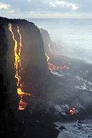 Sunrise, Lava entering the ocean over a 30' sea cliff at East Ka'ili'ili, From Puu Oo vent, Kilauea volcano, Hawaii, USA Volcanoes National Park, Big Island of Hawaii, USA