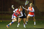 Santa Barbara, CA 02/18/12 - McKinley Carden (Florida #22) and unidentified Chapman player(s) in action during the Chapman - Florida matchup at the 2012 Santa Barbara Shootout.  Florida defeated Chapman 12-11.