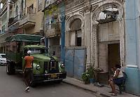 old truck in fron of oriental style art deco building,Havana, Cuba