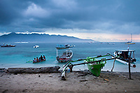 A boat comes into safe harbor as a storm moves in on the tiny island of Gili Air, Indonesia.