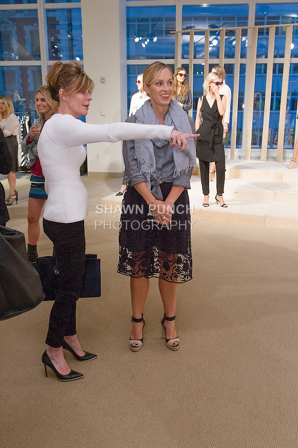 Robbie Myers (left), Editor-In-Chief of Elle Magazine talks with fashion designer Lisa Axelson at the Ann Taylor Spring Summer 2015 collection presentation, October 16, 2014.