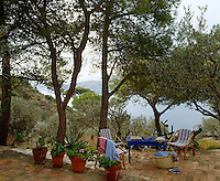Situated under pine and olive trees a brick paved terrace has stunning views to the sea below