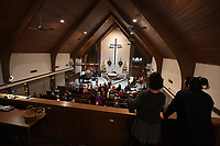 NWA Democrat-Gazette/J.T. WAMPLER Visitors watch from the choir loft before services Sunday Jan. 5, 2020 at Trinity United Methodist Church in Fayetteville.