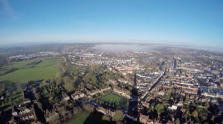 BNPS.co.uk (01202 558833)<br /> Pic: GaryPrice/BNPS.<br /> <br /> Astonishing birds eye view from the spire as its shadow spreads across Salisbury.<br /> <br /> Ultimate selfie - Birds eye view from the worlds tallest medieval building.<br /> <br /> This is Salisbury Cathedral Clerk of Works Gary Price's stomach-flipping view from the dizzying top of Britains tallest spire, something very few people have seen for over 750 years.<br /> <br /> Kitted out in ropes, a harness and a hard hat and accompanied by rope access specialists from Vitruvius Conservation, Gary made the hair-raising climb up the 404ft spire to replace the cathedral's faulty wind meter.