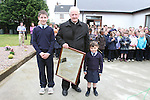 The eldest and youngest children in the School, Arnold Chubukins and Mary Kate Trainor give a presentation to Fr Murtagh at the Official Opening of the new extension at Callystown National School...Photo NEWSFILE/Jenny Matthews.(Photo credit should read Jenny Matthews/NEWSFILE)....This Picture has been sent you under the condtions enclosed by:.Newsfile Ltd..The Studio,.Millmount Abbey,.Drogheda,.Co Meath..Ireland..Tel: +353(0)41-9871240.Fax: +353(0)41-9871260.GSM: +353(0)86-2500958.email: pictures@newsfile.ie.www.newsfile.ie.FTP: 193.120.102.198.
