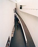 FINLAND, Helsinki, two men having conversation in Kiasma Museum of Contemporary Art