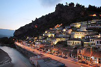 Houses in the Mangalem Quarter and the Osum river in the evening, in Berat, South-Central Albania, capital of the District of Berat and the County of Berat. In July 2008, the old town (Mangalem district) was listed as a UNESCO World Heritage Site. Picture by Manuel Cohen