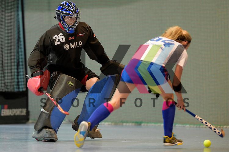 GER - Mannheim, Germany, December 05: During the 1. Bundesliga Sued Damen indoor hockey match between Mannheimer HC (white) and TSV Mannheim (red) on December 5, 2015 at Irma-Roechling-Halle in Mannheim, Germany. Final score 7-1 (HT 5-0).  Viola Schmitt #26 of TSV Mannheim, Vera Battenberg #64 of Mannheimer HC<br /> <br /> Foto &copy; PIX-Sportfotos *** Foto ist honorarpflichtig! *** Auf Anfrage in hoeherer Qualitaet/Aufloesung. Belegexemplar erbeten. Veroeffentlichung ausschliesslich fuer journalistisch-publizistische Zwecke. For editorial use only.