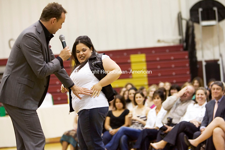 WATERBURY, CT- 23 MAY 2008- 052308JT12- <br /> Clinton Kelly, host of the show &quot;What Not to Wear&quot; on TLC, critiques the fashion choices of Janet Duffany during a fundraising event for St. Mary Magdalen School in Oakville at Sacred Heart High School in Waterbury on Friday evening. Duffany's daughter Hannah is in the same first grade class as Kelly's nephew. The money raised will go to the second phase of expanding the St. Mary Magdalen School, which will include finishing a new kindergarten classroom, a new all-purpose room, and a new library/ media center. The expansion campaign needs $300,000 more to reach it's goal of $1.5 million.<br /> Josalee Thrift / Republican-American