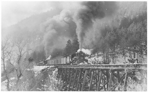Pilog end, engineer side view of RGS K-27 #464 heading northbound with 17 cars across bridge 18-C at Leopard Creek.  K-27 #455 is cut in the middle.<br /> RGS  Leopard Creek, CO  Taken by Perry, Otto C. - 10/5/1950