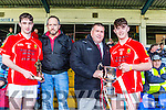 East Kerry Captain David Spillane is presented the cup by County board Chairman Patrick O'Sullivan and Daniel O'Brien is presented the man of the match by Seamus Kerrisk Garveys after winning the County Minor Championship final in Fitzgerald Stadium on Sunday