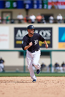 Detroit Tigers shortstop Jordy Mercer (7) runs the bases during a Grapefruit League Spring Training game against the New York Yankees on February 27, 2019 at Publix Field at Joker Marchant Stadium in Lakeland, Florida.  Yankees defeated the Tigers 10-4 as the game was called after the sixth inning due to rain.  (Mike Janes/Four Seam Images)