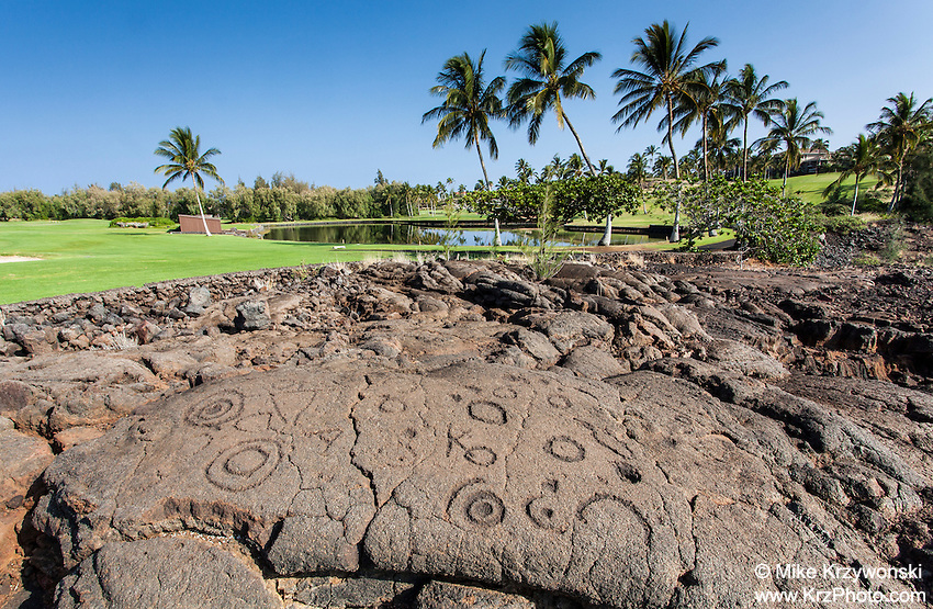 Petroglyphs along the King's Course golf course at the Waikoloa Petroglyph Field, Big Island, Hawaii