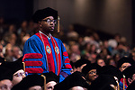 Steven Haamid stands to be recognized as a recipient of a Student Service Award during the DePaul University College of Law commencement ceremony, Sunday, May 14, 2017, at the Rosemont Theatre in Rosemont, IL, where some 240 students received their Juris Doctors or Master of Laws degrees. The Rev. Dennis H. Holtschneider, C.M., president of DePaul, conferred the degrees. (DePaul University/Jeff Carrion)
