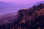 Columbia River Gorge National Scenic Area Crown Point State Scenic Corridor Crown Point with Vista House lookout and observatory sunset with Autumn colors Oregon State USA