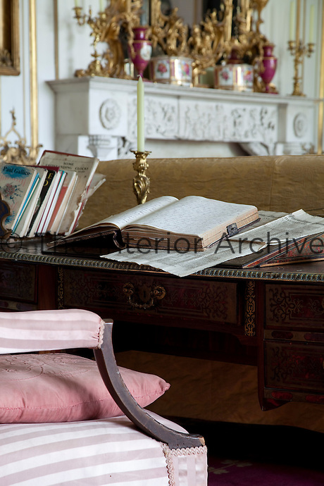 An old Dublin newpaper sits on the writing desk in the drawing room among other vintage documents