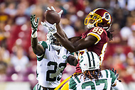 Landover, MD - August 16, 2018: Washington Redskins wide receiver Cam Sims (89) catches a pass between New York Jets defensive back Terrence Brooks (23) and New York Jets cornerback Darryl Roberts (27) for a first down during preseason game between the New York Jets and Washington Redskins at FedEx Field in Landover, MD. (Photo by Phillip Peters/Media Images International)