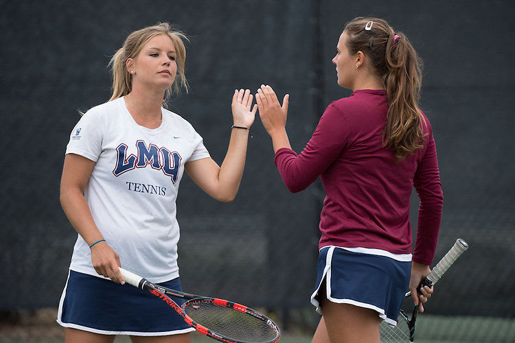 April 22, 2015; San Diego, CA, USA; Loyola Marymount Lions tennis players Andrea Crespo (left) and Julia Norlin (right) during the WCC Tennis Championships at Barnes Tennis Center.
