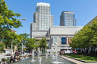 People enjoy the fountains in Renaissance Park Plaza at lunchtime in downtown White Plains, New York.