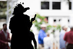 LOUISVILLE, KENTUCKY - MAY 02: A fan checks her phone during Thurby at Churchill Downs in Louisville, Kentucky on May 02, 2019. Evers/Eclipse Sportswire/CSM