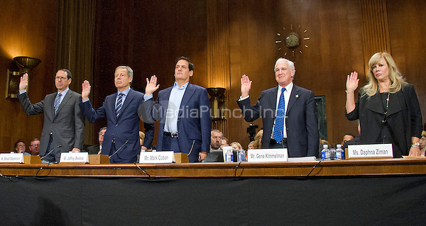 """From left to Right: Randall Stephenson, Chairman & Chief Executive Officer AT&T; Jeffrey Bewkes, Chairman & Chief Executive Officer,Time Warner; Mark Cuban, Chairman, AXS TV, Owner, Dallas Mavericks, Landmark Theatres, and Magnolia Pictures; Gene Kimmelman, President & Chief Executive Officer, Public Knowledge; and Daphna Ziman, President, Cinémoi, are sworn-in to testify before the United States Senate Committee on the Judiciary Subcommittee on Antitrust, Competition Policy & Consumer Rights hearing """"Examining the Competitive Impact of the AT&T-Time Warner Transaction"""" on Capitol Hill in Washington, DC on Wednesday, December 7, 2016.<br /> Credit: Ron Sachs / CNP /MediaPunch"""