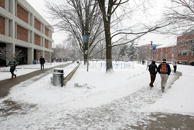 Students walk on patchy sidewalks on Monday as classes are still in session until 5 p.m. on Monday. Photo by Scott Hannigan | Staff