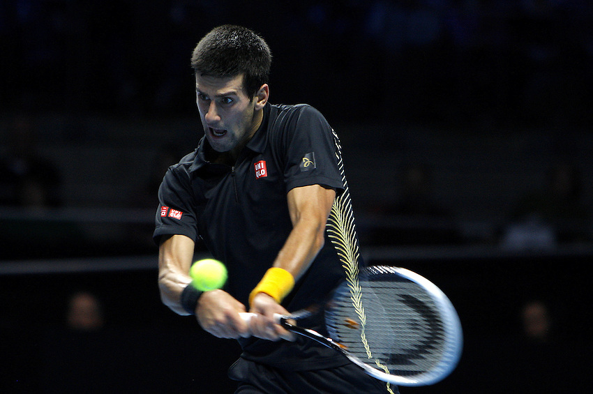 Novak Dkokovic (SRB) in action today during his victory over Jo-Wilfried Tsonga(FRA) in their Group A match- N Djokovic (SRB) def Jo Wilfried Tsonga 7-6(4) 6-3..International Tennis - Barclays ATP World Tour Finals - O2 Arena - London - Day 1 Monday 5th November 2012..