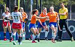 BLOEMENDAAL - Kim van Leeuwen (Bldaal) heeft gescoord en viert het met met Sanne Caarls (Bldaal) en Carmel Bosch (Bldaal)  tijdens de tweede Play Out wedstrijd hockey dames, Bloemendaal-MOP (5-1)  COPYRIGHT KOEN SUYK