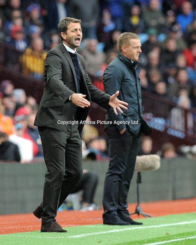 Manager Garry Monk of Swansea City and Manager Tim Sherwood of Aston Villa during the Barclays Premier League match between Aston Villa v Swansea City played at the Villa Park Stadium, Birmingham on October 24th 2015