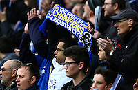 A Leicester City fan with a champions scarf during the Barclays Premier League match between Leicester City and Swansea City played at The King Power Stadium, Leicester on 24th April 2016