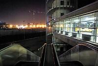 """milano, fieramilanocity di notte. sullo sfondo il cantiere per la costruzione del nuovo quartiere portello --- milan, the """"fieramilanocity"""" fair building at night. on the background, construction site of the portello district"""