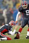 17 December 2006: Buffalo Bills kicker Rian Lindell (9) takes a practice kick as punter Brian Moorman (8) holds the ball prior to a game against the Miami Dolphins at Ralph Wilson Stadium in Orchard Park, New York. The Bills defeated the Dolphins 21-0.. .Mandatory Photo Credit: Ed Wolfstein Photo<br />