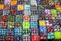 Dice of tantalizing colors for sale through vendors at the Grand Prix. Players use them as &quot;counters&quot; that mark changes in game play. <br /> <br />  <br /> Danny Ghitis for Bloomberg Businessweek