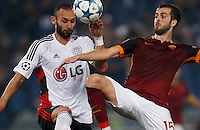 Leverkusen's Omer Toprak fight for the ball with  AS Roma's Miralem Pjanic  during the Champions League Group E soccer match between As Roma and  Bayer Leverkusen at the Olympic Stadium in Rome, November 04 2015