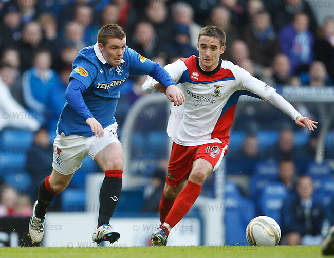 John Fleck runs inside Caley's Nick Ross