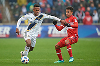 Bridgeview, IL - Saturday April 14, 2018: Ola Kamara, Brandon Vincent during a regular season Major League Soccer (MLS) match between the Chicago Fire and the LA Galaxy at Toyota Park.  The LA Galaxy defeated the Chicago Fire by the score of 1-0.