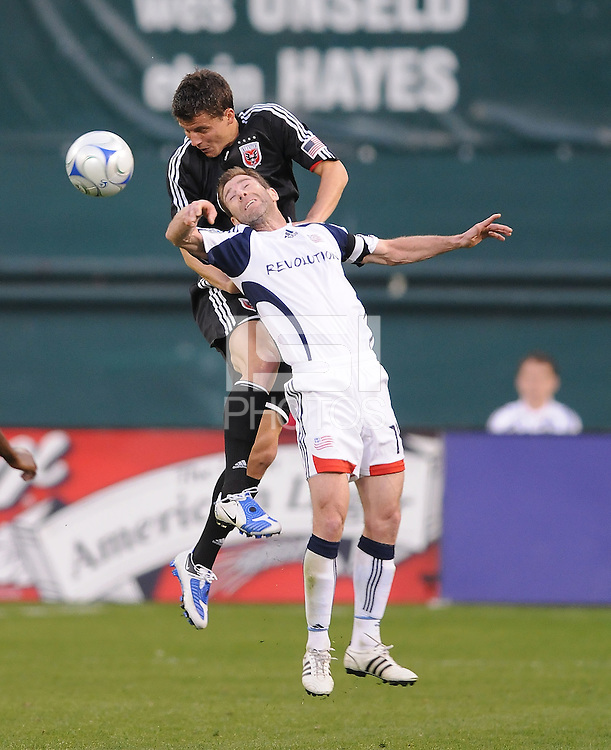 DC United defender Marc Burch (4) jumps to head the ball against New England Revolution forward Steve Ralston (14)   DC United tied The New England Revolution 1-1 at  RFK Stadium, Friday April 17, 2009.